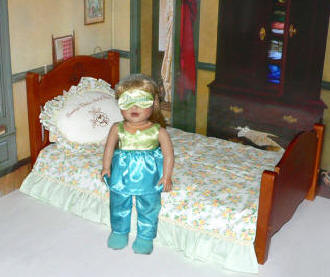 blue pajamas and valuable doll bed