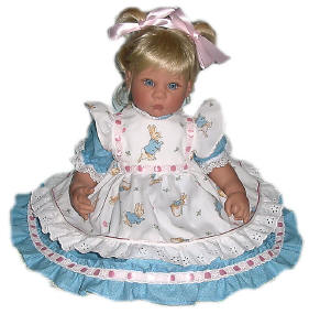 Lee Middleton doll wearing a Beatrix Potter Pinafore