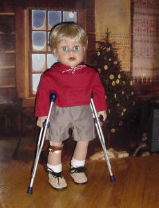 Boy doll with crutches and prosthetics