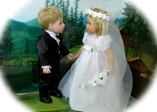 Boy doll in tuxedo set and 18 inch girl doll in a bridal gown
