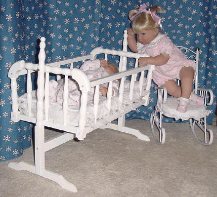 Swinging baby doll cradle