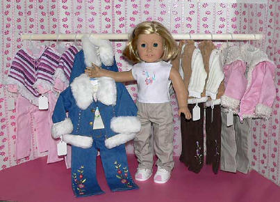 American Girl in front of Doll Clothes