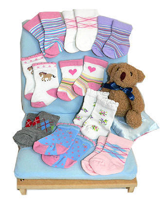 An array of designer doll socks for American girls and Amazing Ally dolls.